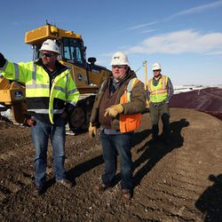 Mike Larsen, Jeff Harrison and Blaine Cozzens work on a temporary road to access the new prison site in Salt Lake City on Wednesday, Dec. 28, 2016.