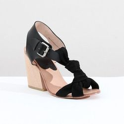 """<a href=""""http://shop.creaturesofcomfort.us/A-Detacher-hesse-sandal-black.aspx"""">A Detacher Hesse Sandal</a>, $475 at Creatures of Comfort"""