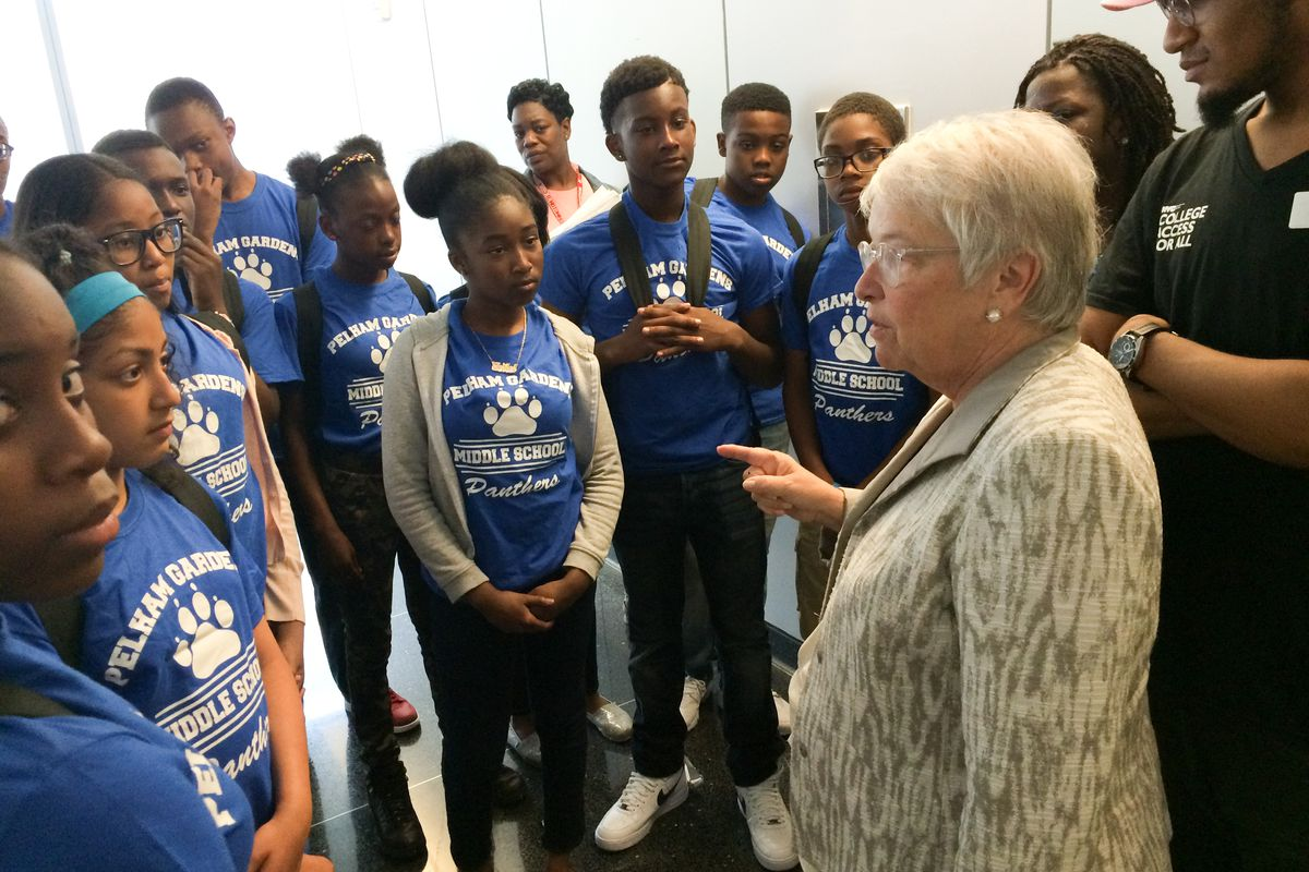 Former New York City Schools Chancellor Carmen Fariña asks students from Pelham Gardens Middle School about their favorite part of touring John Jay College of Criminal Justice. The tour was part of the College Access for All's program.