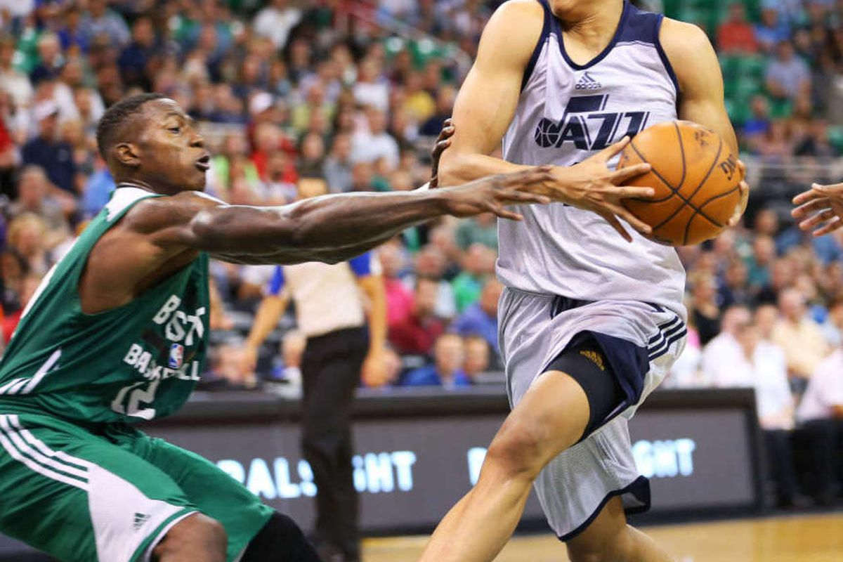 Utah's Dante Exum drives the lane on Boston's Terry Rozier as the Utah Jazz and the Boston Celtics play Monday, July 6, 2015, in Summer League action at EnergySolutions Arena in Salt Lake City Utah. Jazz won 100-82.