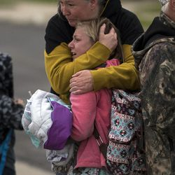 A woman consoles a young girl after a tornado struck Washington Terrace on Thursday, Sept. 22, 2016. Officials said nobody was injured in the twister.