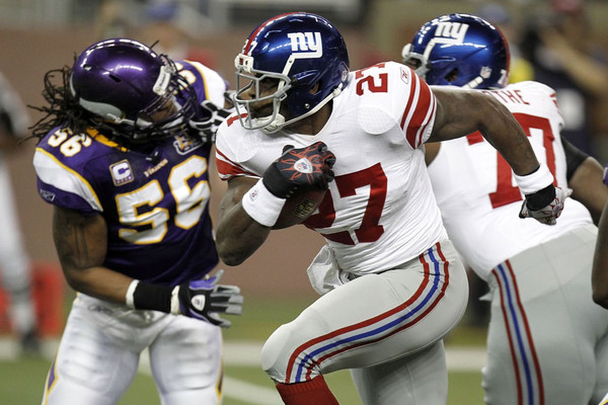 Brandon Jacobs (27) of the New York Giants tries to outrun the tackle of E.J. Henderson (56) of the Minnesota Vikings at Ford Field on December 13 2010 in Detroit Michigan.  (Photo by Gregory Shamus/Getty Images)