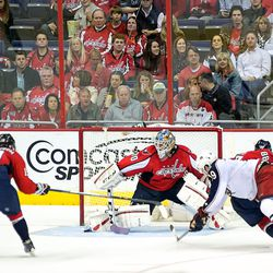 Holtby Brushes Puck Aside