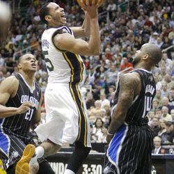 Utah Jazz guard Devin Harris (5) pushes up a shot between Orlando's #21 Daniel Orton, left, and #14 Jameer Nelson as the Utah Jazz and the Orlando Magic play Saturday, April 21, 2012 in Energy Solutions arena.
