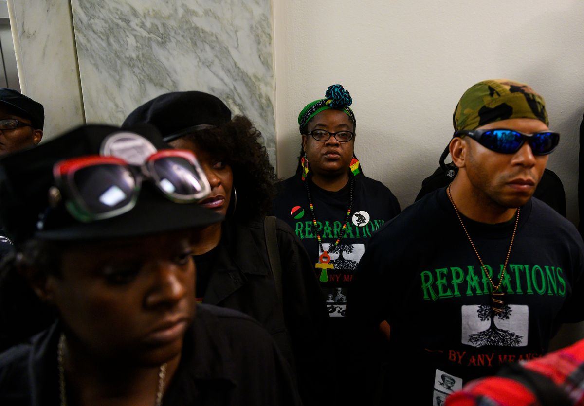 Activists wait to enter a congressional hearing on reparations convened by the House Judiciary Subcommittee on the Constitution, Civil Rights, and Civil Liberties on June 19, 2019.