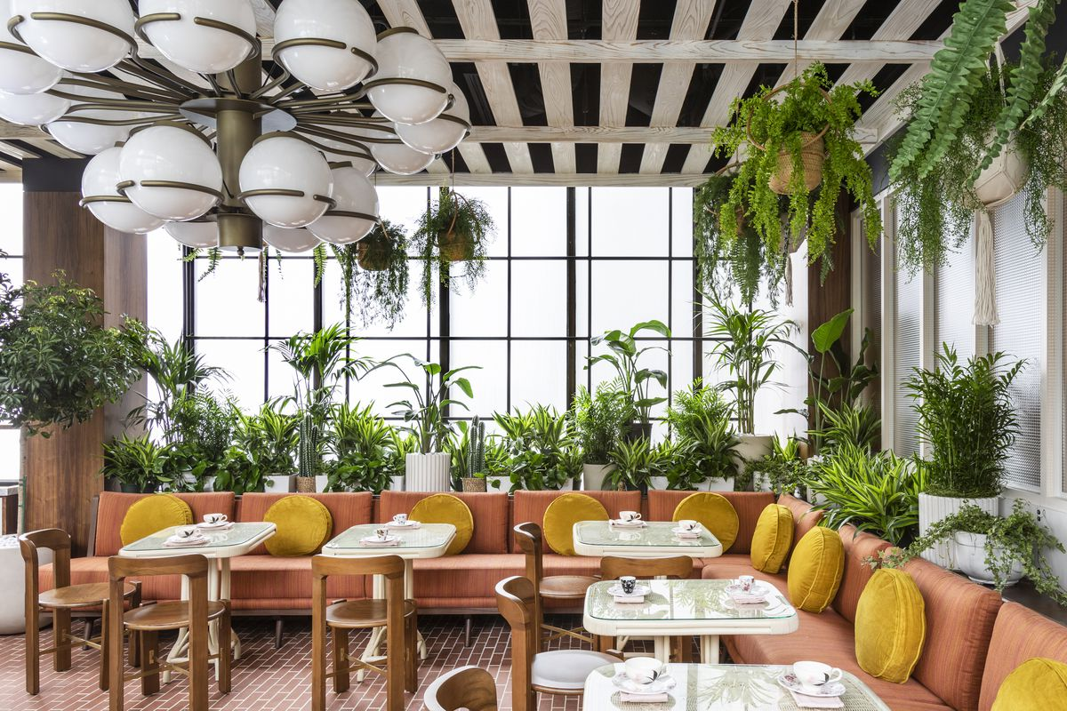 The plant-filled dining room of Rosalie in Houston.