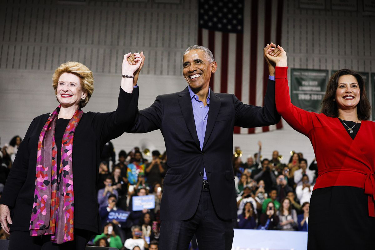Former President Barack Obama with Michigan Senator Debbie Stabenow (left) and Michigan gubernatorial candidate Gretchen Whitmer (right) at a rally to support Michigan democratic candidates in Detroit on October 26, 2018