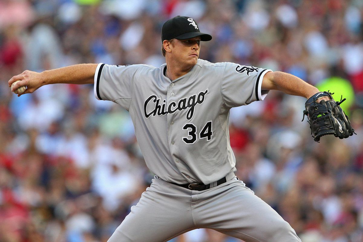 June 26, 2012; Minneapolis, MN, USA: Chicago White Sox starting pitcher Gavin Floyd (34) delivers a pitch in the first inning against the Minnesota Twins at Target Field. Mandatory Credit: Jesse Johnson-US PRESSWIRE