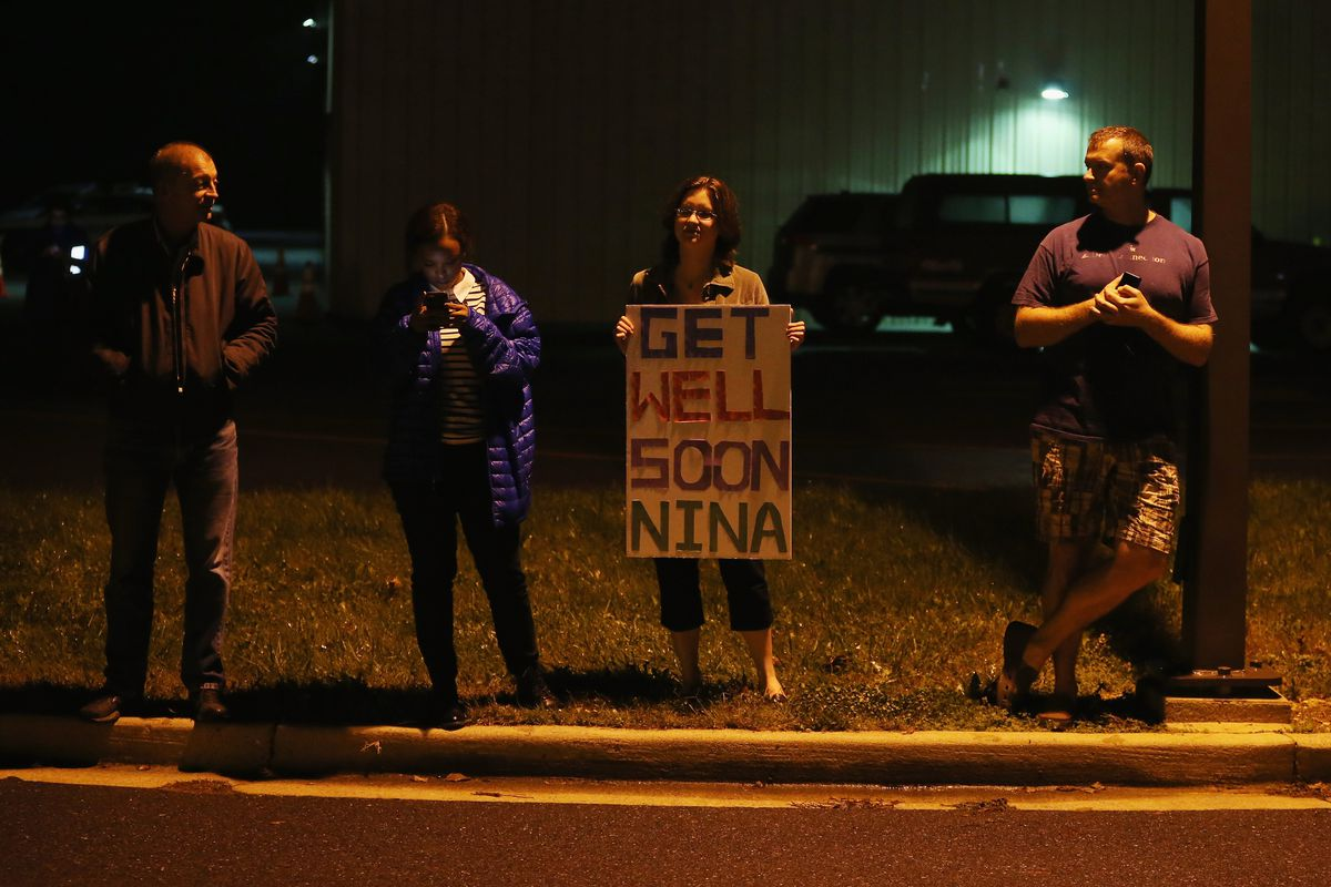 Demonstrators show support for Nina Pham, the Texas nurse who contracted Ebola from a patient in the US.