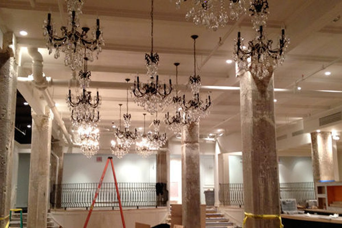 16 Schonbek chandeliers hang from the ceiling