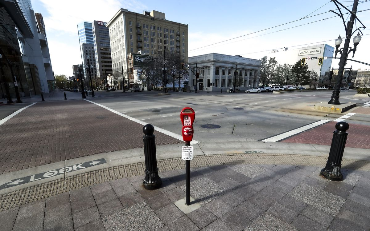 The intersection at 100 South and Main in downtown Salt Lake City is empty during the morning commute on Monday, April 13, 2020, due the COVID-19 pandemic.