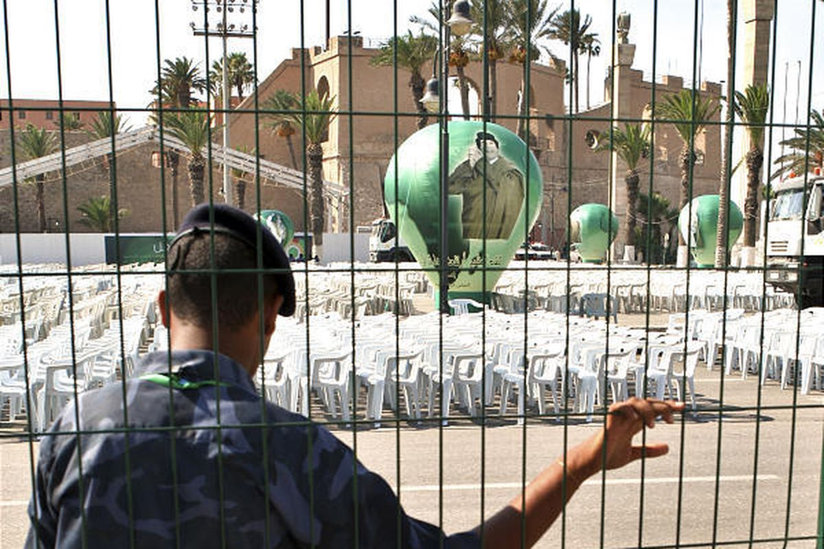 A Libyan soldier stands guard Thursday at Tripoli's Green Square, a sweeping plaza where thousands of chairs had been set up, in anticipation of an appearance by  Abdel Baset al-Megrahi and Seif al-Islam Gadhafi, son of Libyan leader Moammar Gadhafi. Howe