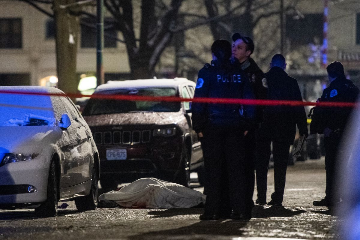 Chicago Police investigate the scene where a man was shot and killed Sunday night in the 7000 block of South Cregier, in the South Shore neighborhood.   Tyler LaRiviere/Sun-Times