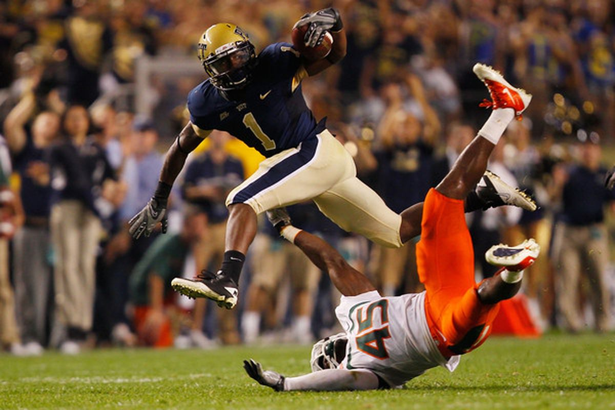 PITTSBURGH - SEPTEMBER 23:  Ray Graham #1 of the Pittsburgh Panthers evades a tackle by Ramon Buchanan #45 of the Miami Hurricanes on September 23 2010 at Heinz Field in Pittsburgh Pennsylvania.  (Photo by Jared Wickerham/Getty Images)