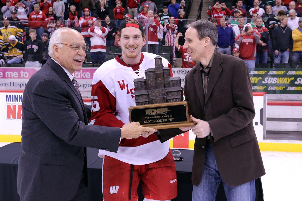 John Ramage acceps the Broadmoor Trophy on behalf of the Badgers.