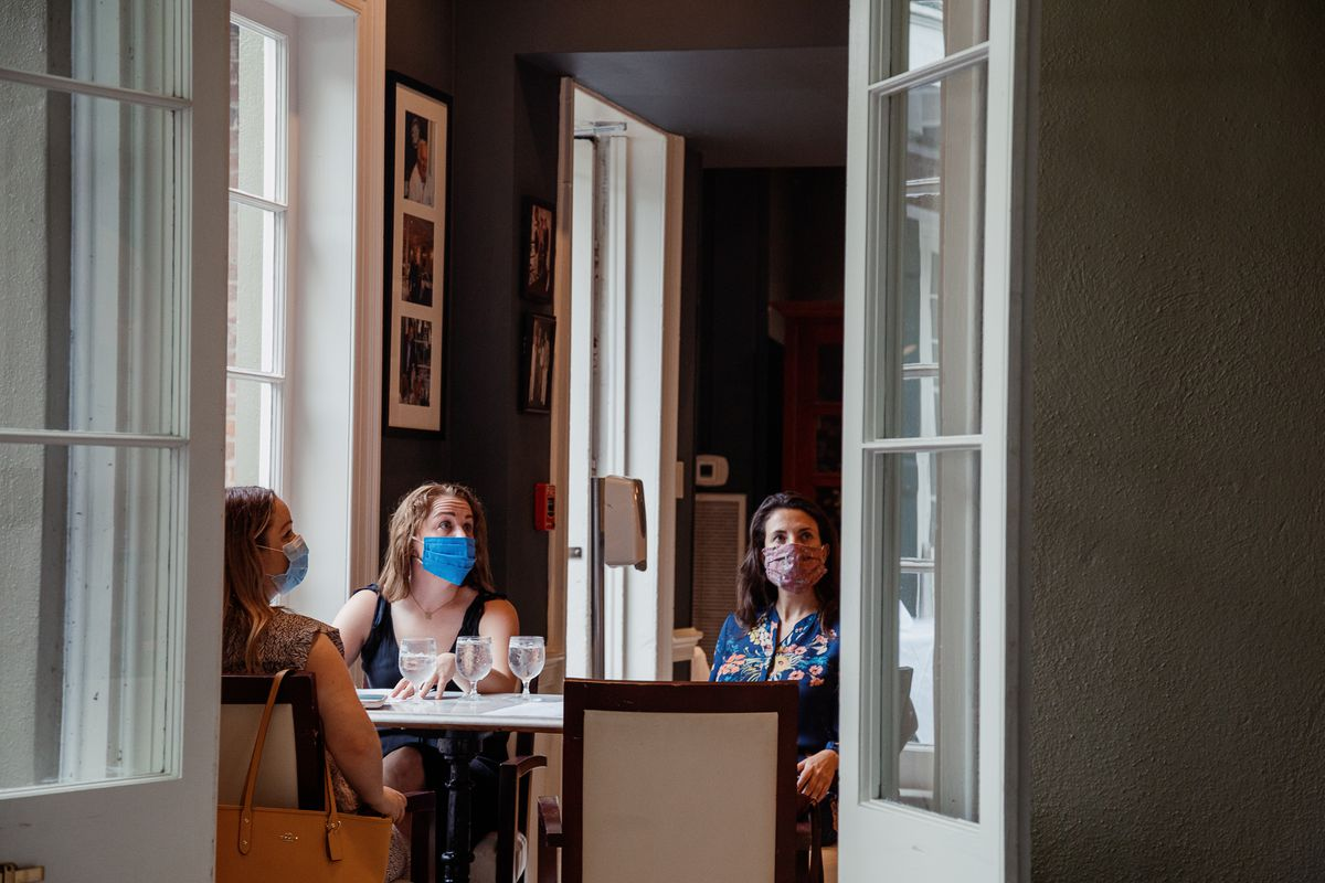 Patrons are masked inside a Louisiana restaurant