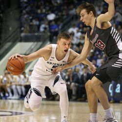 Brigham Young Cougars guard Jake Toolson (5) drives against Santa Clara Broncos forward Josip Vrankic (13) at Brigham Young University in Provo on Thursday, Feb. 20, 2020.