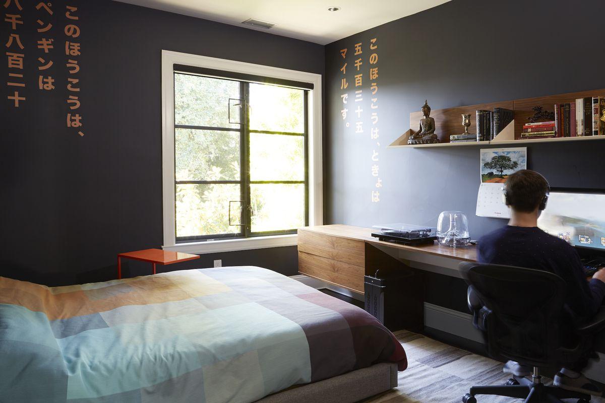 a black bedroom office