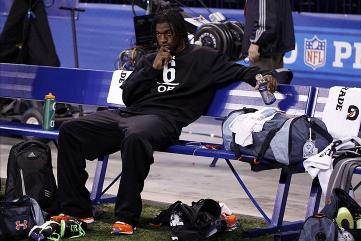 Feb 26, 2012; Indianapolis, IN, USA; Baylor Bears quarterback Robert Griffin III watches other players work out during the NFL Combine at Lucas Oil Stadium. Mandatory Credit: Brian Spurlock-US PRESSWIRE
