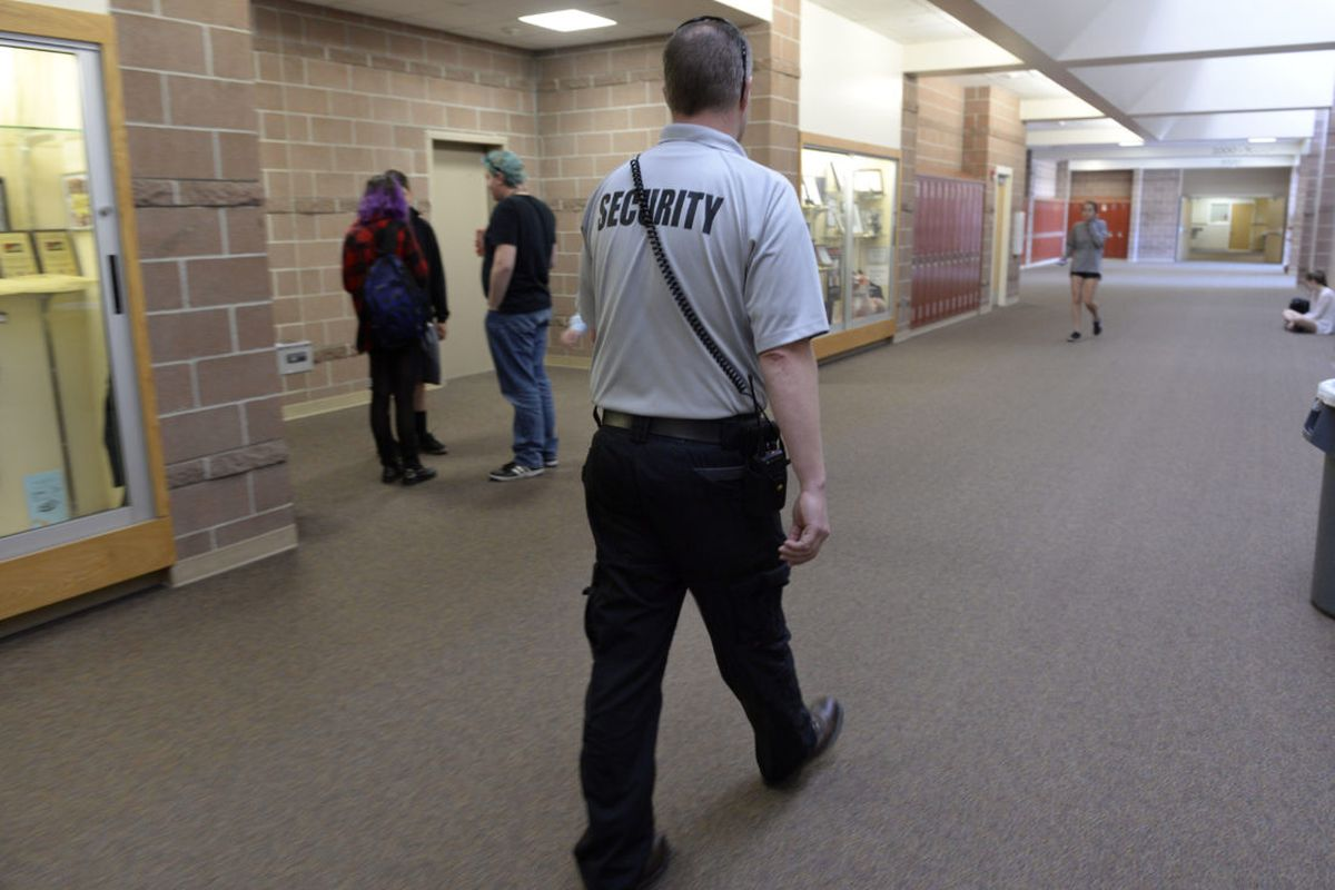 Douglas County School District security officer Ian Scott patrols the halls and checks in with students at Rock Canyon High School in 2017. (Photo by Kathryn Scott/The Denver Post via Getty Images)