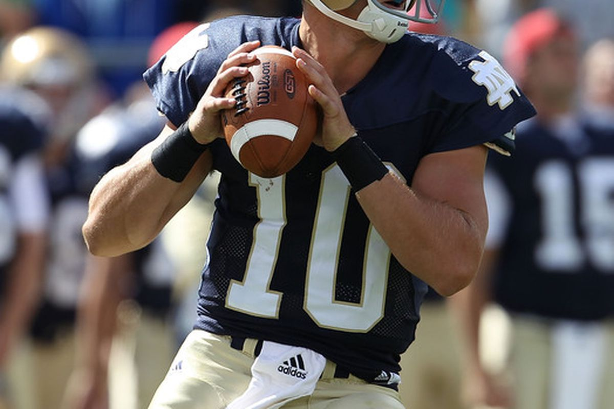 SOUTH BEND IN - SEPTEMBER 04: Dayne Crist #10 of the Notre Dame Fighting Irish looks for a receiver against the Purdue Boilermakers at Notre Dame Stadium on September 4 2010 in South Bend Indiana. (Photo by Jonathan Daniel/Getty Images)