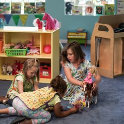 Blakelynn Adams, 4, Makaia Taylor, 6, and Lilly Virga, 7, play together at Sunshine Academy Preschool & Daycare in Alpine on Thursday, May 14, 2020. Sunshine Academy is one of several child care centers that have been approved to reopen, with a number of strict new operating guidelines, to serve the children of essential workers during the COVID-19 pandemic.