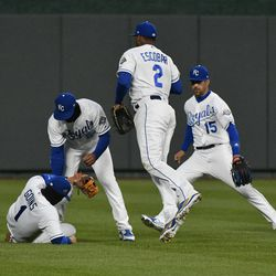 A ball hit by Albert Pujols drops between four Royals players.