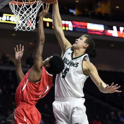 Utah Valley's Hayden Schenck (5) blocks a shot by Seattle's Morgan Means during the first half of an NCAA college basketball game in the first round of the Western Athletic Conference tournament Thursday, March 9, 2017, in Las Vegas.