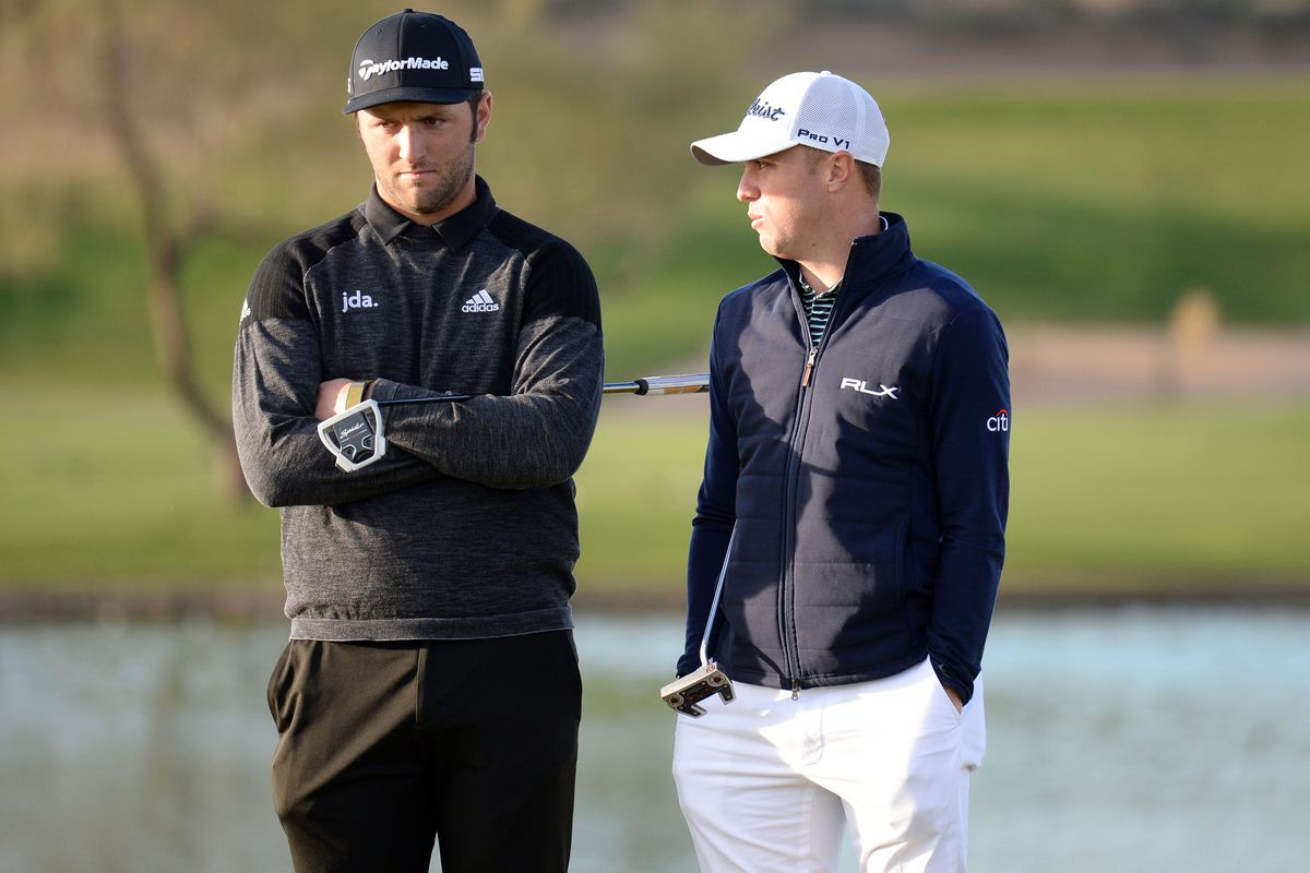 Jon Rahm and Justin Thomas talk on the 11th fairway during the first round of the Waste Management Phoenix Open golf tournament at TPC Scottsdale.