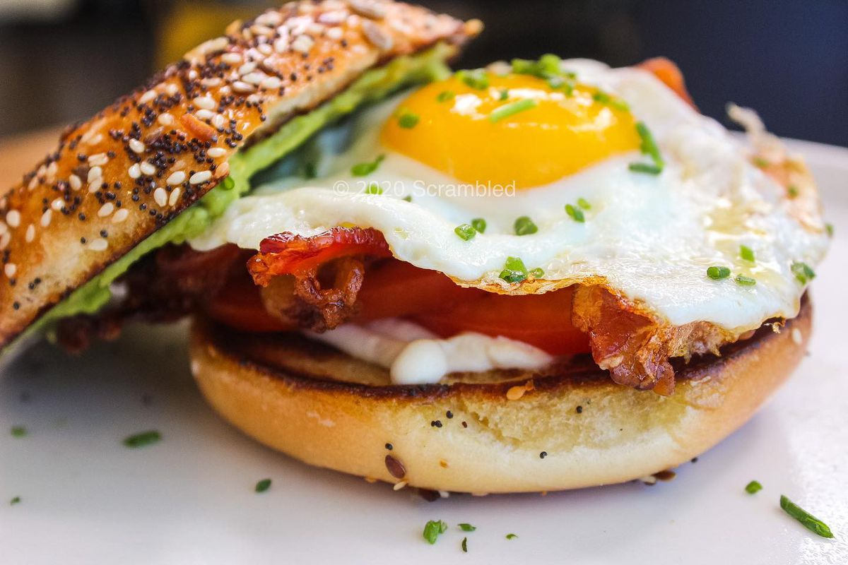 An over-easy egg and bacon on a bagel