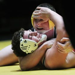 Wrestlers compete in the 5A boys state championship at Wasatch High in Heber on Thursday, Feb. 18, 2021.