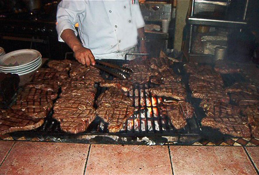 Steaks on the mesquite grill at the Bob Taylor's Ranch House, the oldest surviving restaurant in Las Vegas.
