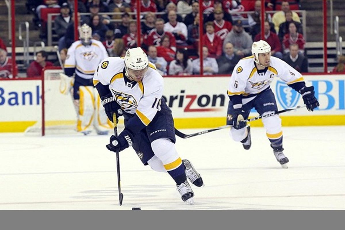 February 28, 2012; Raleigh, NC, USA; Nashville Predators right wing Martin Erat (10) carries the puck against the Carolina Hurricanes at the RBC center. The Hurricanes defeated the Predators 4-3. Mandatory Credit: James Guillory-US PRESSWIRE