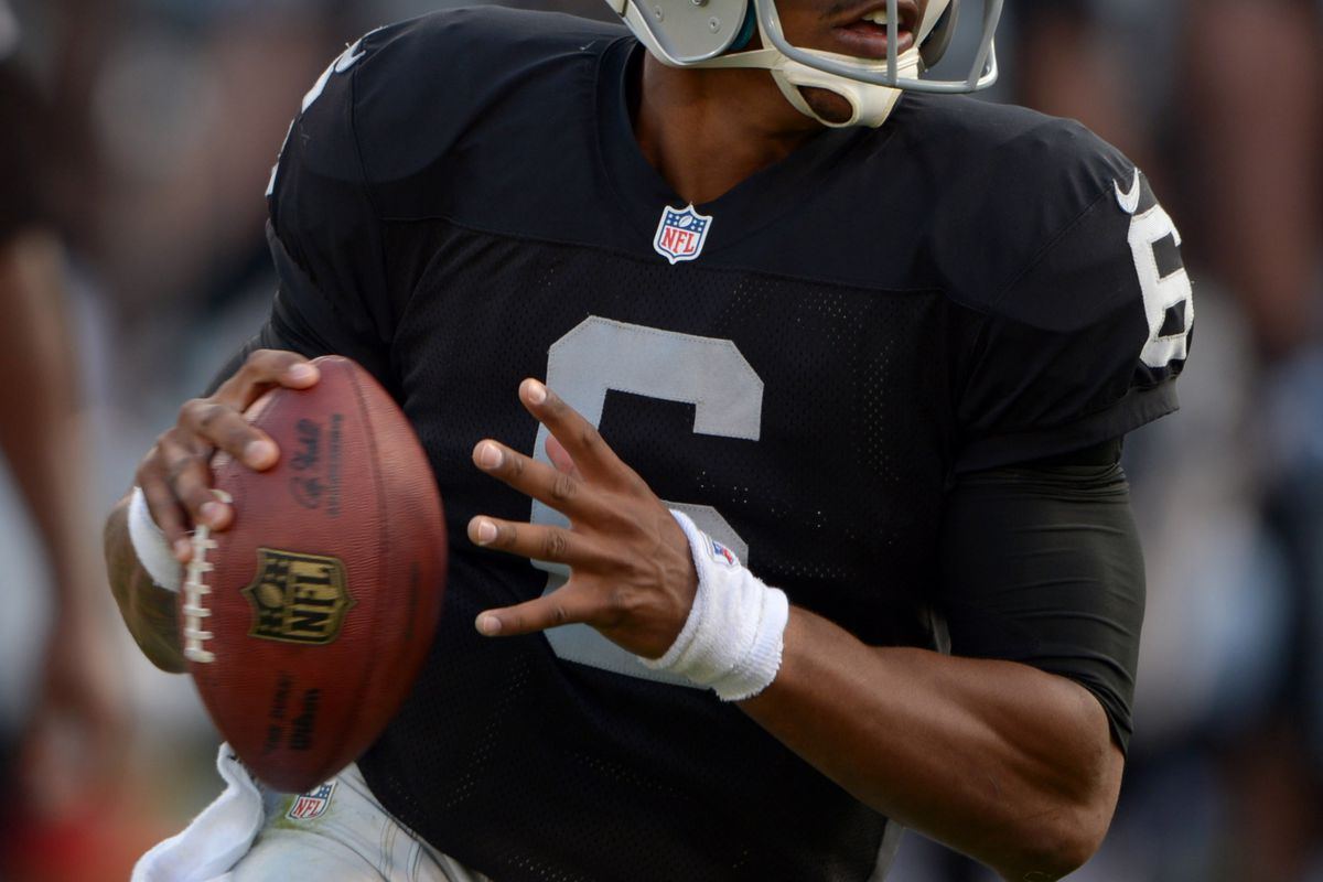 Oakland Raiders quarterback Terrelle Pryor (6) rolls out during the game against the Detroit Lions at O.co Coliseum.
