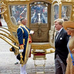 """Netherlands' King Willem-Alexander and his wife Queen Maxima arrive for the opening of the new parliamentary year with a speech outlining the government's plan and budget policies for the year ahead, at the 13th century """"Hall of Knights"""" in The Hague, Netherlands, Tuesday, Sept. 17, 2013."""