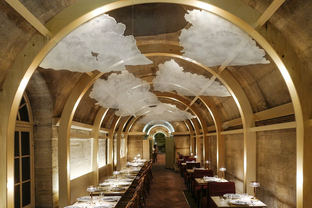 Room with arched ceilings and art installation