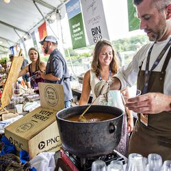 Seafood R'evolution's Payton Warren scoops out a Mississippi-style seafood gumbo.