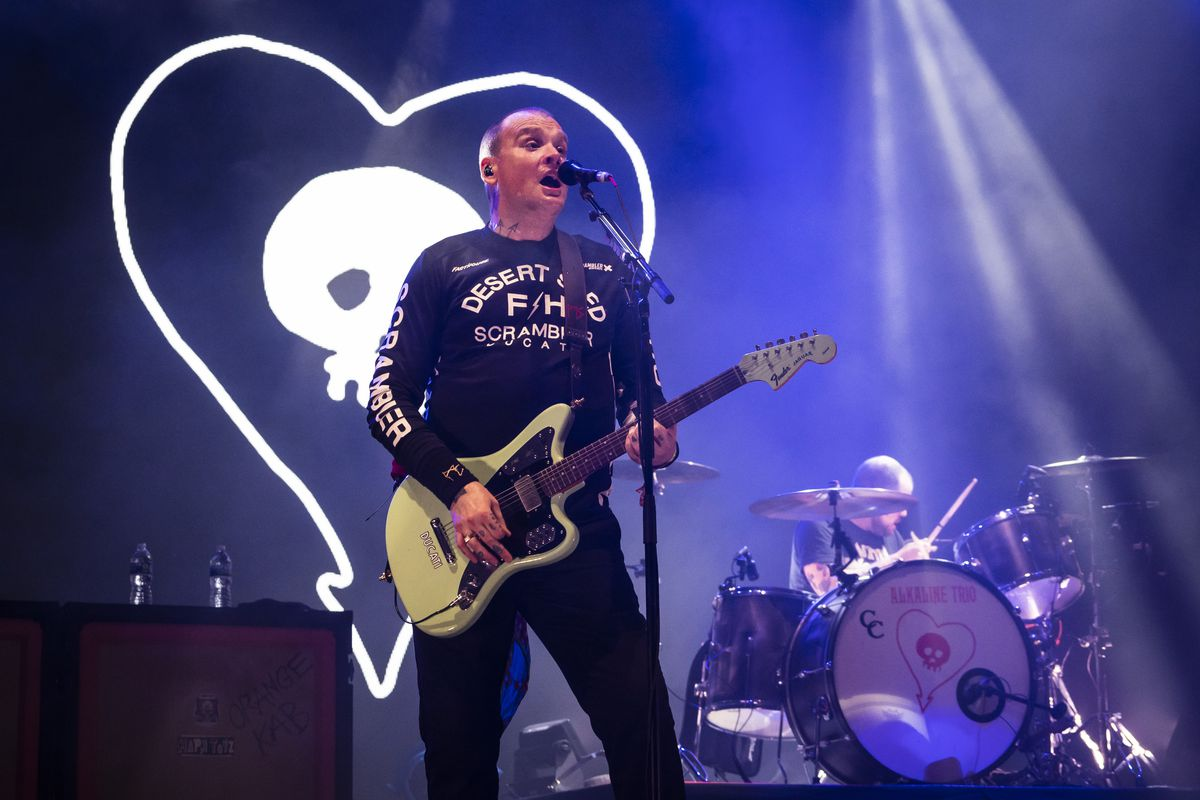 """Alkaline Trio performs Thursday during the """"preview party"""" of Riot Fest in Douglass Park."""