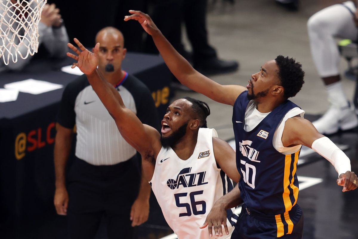 Utah Jazz White team's Jahlil Tripp and Utah Jazz Blue team'sShaqquan Aaron face off in the summer league at Vivint Arena.