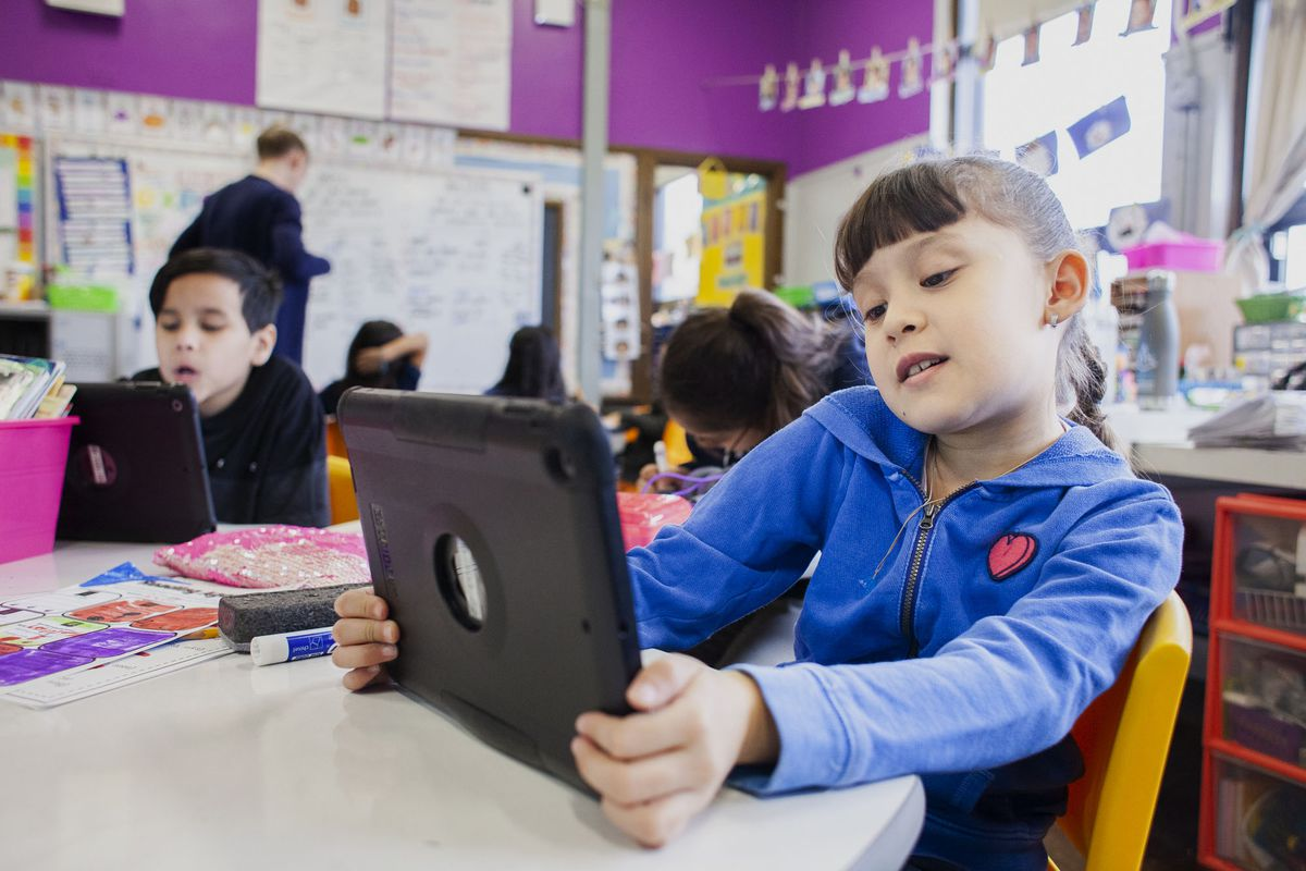 Aileen R. completes a reading program on her iPad during class at CICS West Belden. The Chicago charter school employs the personalized learning method for its K-8 students. The school is part of the Chicago International Charter School network, and is managed by Distinctive Schools,. Photo by Stacey Rupolo/Chalkbeat NOTE: Last names not given by school