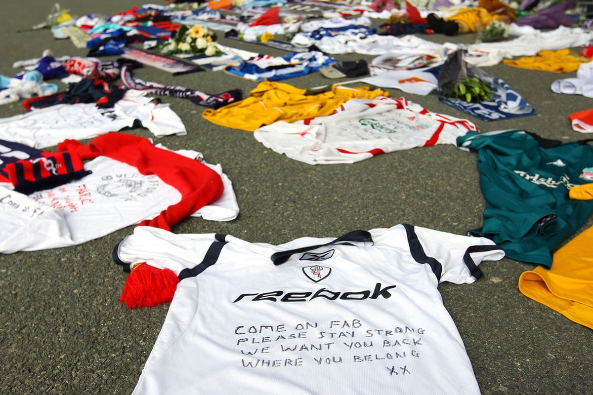 Tributes and get well messages are laid outside the Reebok Stadium for Bolton Wanderers' Fabrice Muamba at Reebok Stadium.