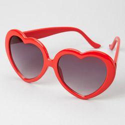 "Heart Shaped Sunglasses, <a href=""http://www.fredflare.com/ACCESSORIES-sunglasses/Heart-Shaped-Sunglasses/"">$14</a>"