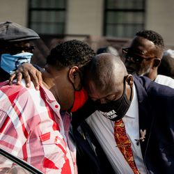 Attorney Ben Crump, who is representing the Blake family, talks to Jacob Blake Sr., the father of Jacob Blake, after a press conference Tuesday afternoon, Aug. 25, 2020. Police shot Blake at least seven times in the back Sunday as he was breaking up a fight, according to his attorneys.