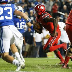 Utah Utes quarterback Tyler Huntley (1) runs for a touchdown, putting the Utes up 16-0 over the Brigham Young Cougars in the third quarter at LaVell Edwards Stadium in Provo on Saturday, Sept. 9, 2017.