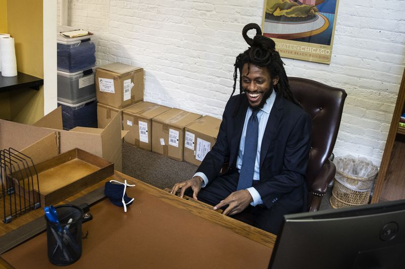 Newly appointed state Sen. Mike Simmons sits at his desk for the first time at his district office in the Edgewater neighborhood in February.