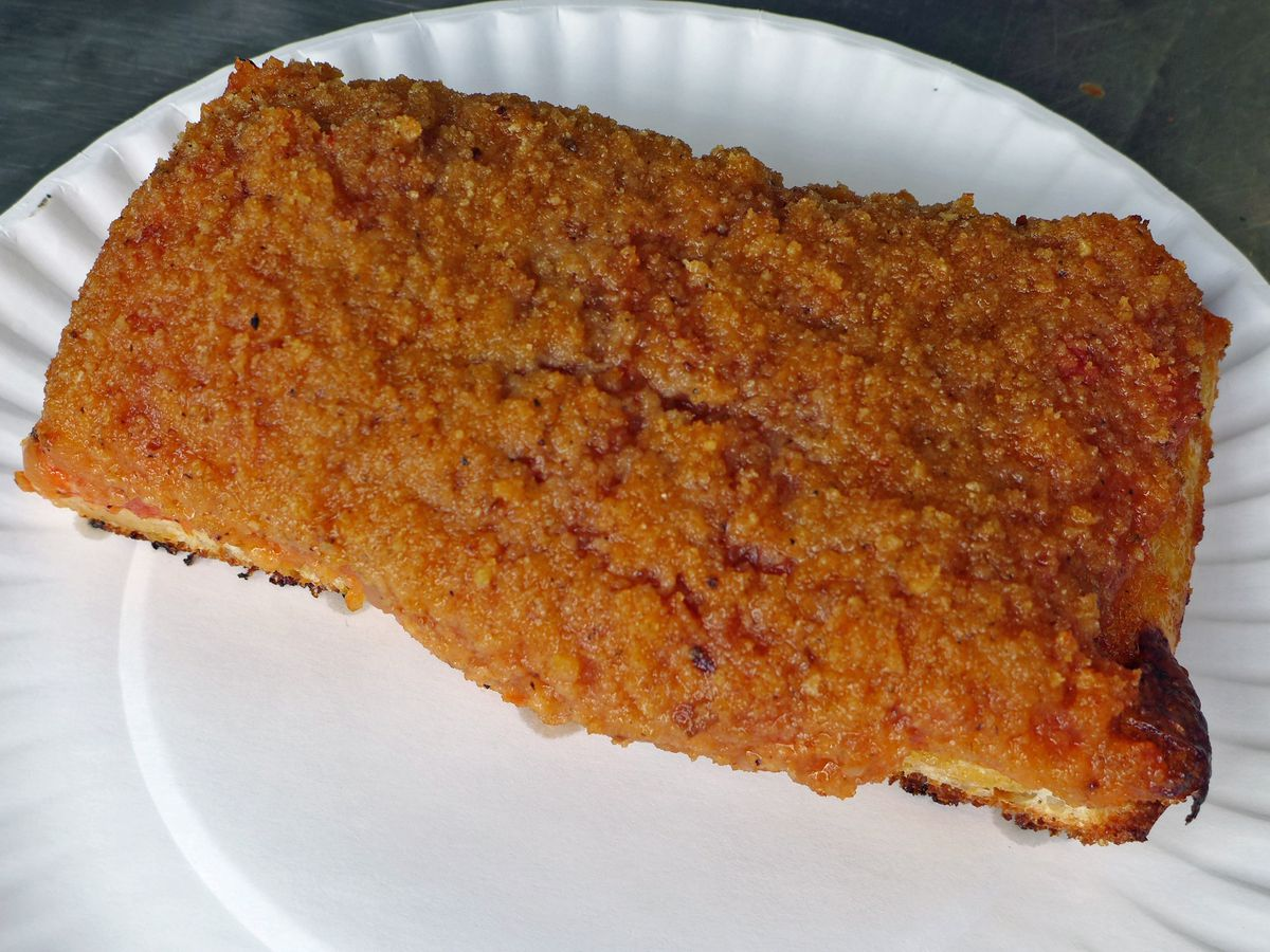 A rectangular slice on a paper plate.