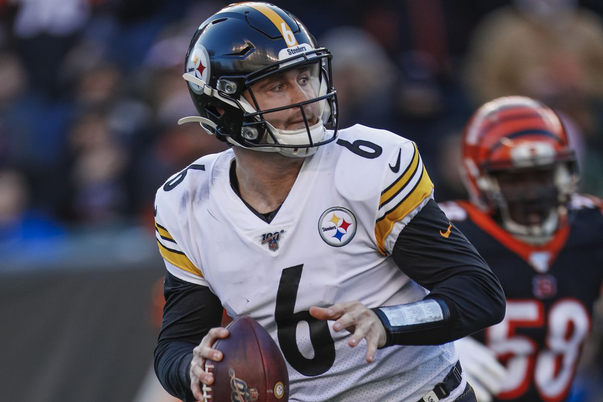 Devlin Hodges of the Pittsburgh Steelers scrambles out of the pocket during the game against the Cincinnati Bengals at Paul Brown Stadium on November 24, 2019 in Cincinnati, Ohio.