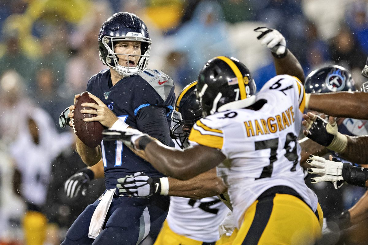 Ryan Tannehill #17 of the Tennessee Titans drops back to pass under pressure during a game against the Pittsburgh Steelers during week three of preseason at Nissan Stadium on August 25, 2019 in Nashville, Tennessee. The Steelers defeated the Titans 18-6.