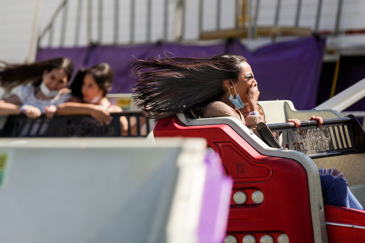Berta Murillo's hair goes flying as she takes a ride with her sister, Kendra, 5, at the Utah State Fair at the fairpark in Salt Lake City on Friday, Sept. 11, 2020.