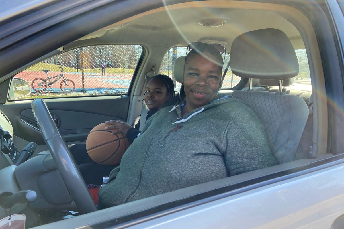 Shelly Franklin and her grandson stopped by a basketball court in Detroit on Friday afternoon. Schools across Michigan were closed to slow the spread of the coronavirus.